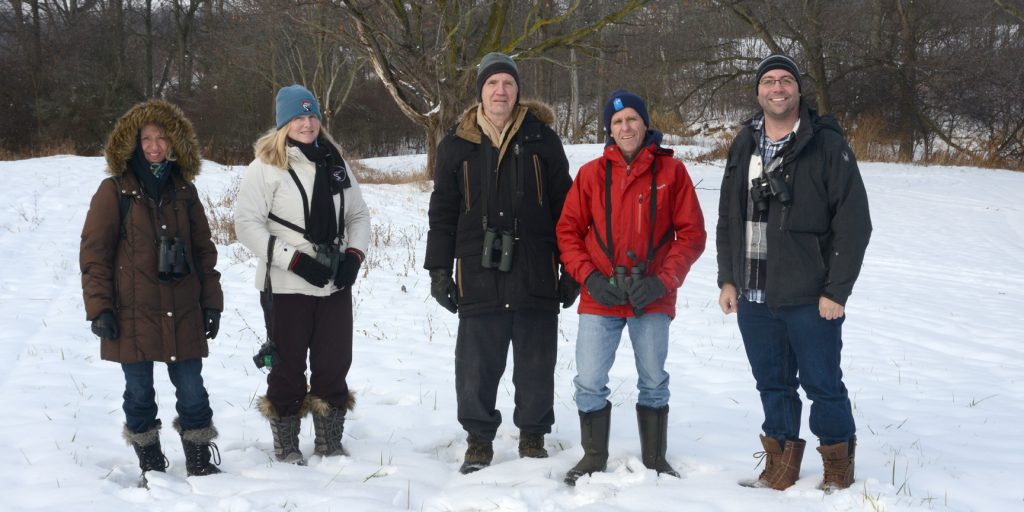 Group photo of Peninsula Field Naturalists outdoors in the Canadian winter