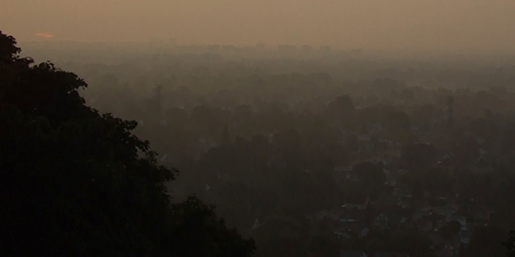 Airborne particulates, smog above residential and natural areas Hamilton
