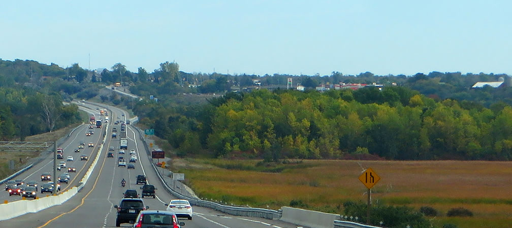 Highway along farmlands and natural areas