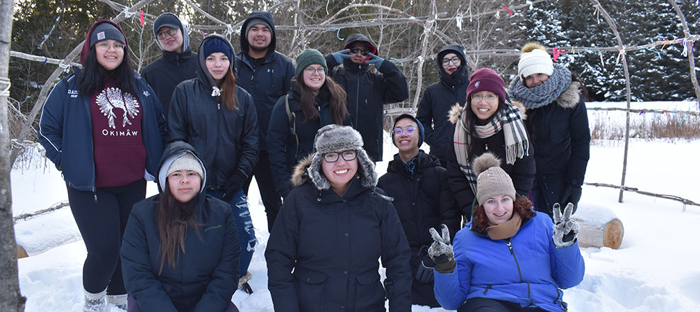 Youth Circle for Mother Earth Leadership Retreat group photo outside in beautiful natural winter scenery