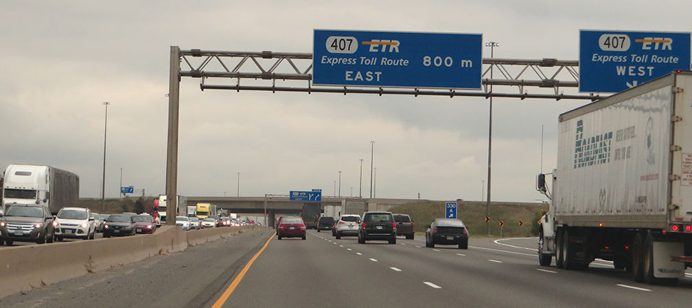 Traffic and trucks, Highway 407 signs