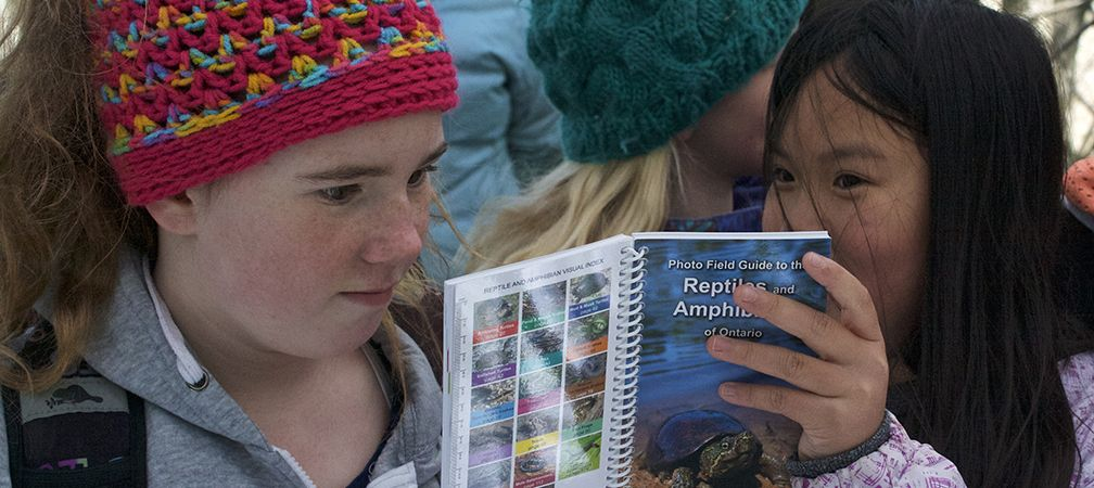 Two girls discover, Identify and reporting species at a Sydenham River Nature Reserve event