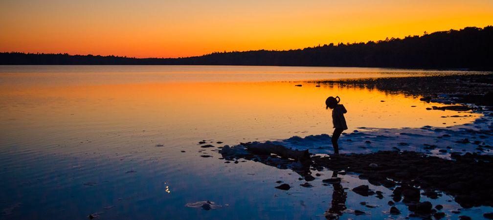Child explores shore, Bruce Peninsula National Park, Saugeen Peninsula